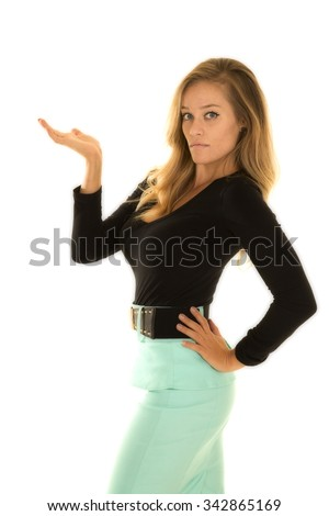 a woman in her green pencil skirt with a black top with her hand up.