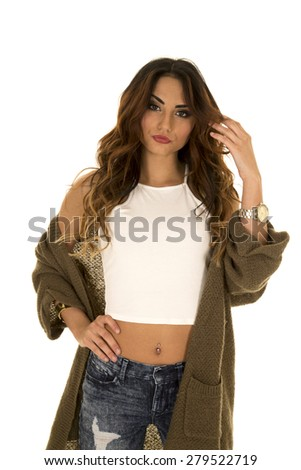 A woman in her green sweater and crop top, with a sensual expression. - stock photo