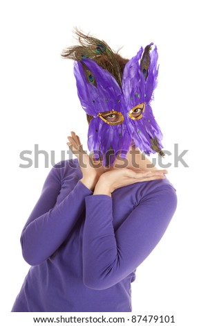 A woman in her purple mask hiding her face.