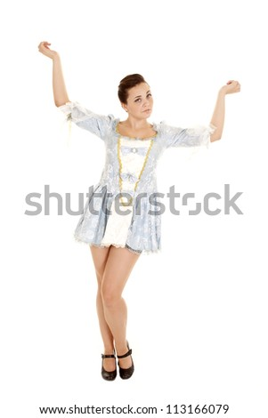 A woman in her short dress with her hands up in the air being serious - stock photo