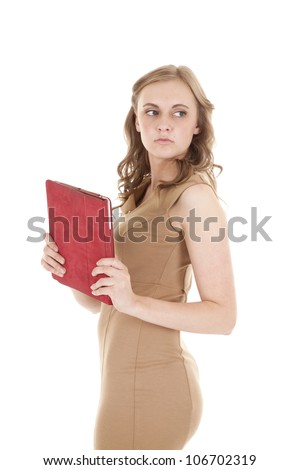 A woman in her tan dress with her red tablet with a serious expression on her face. - stock photo