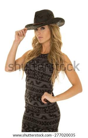 a woman in her western dress, wearing her western hat.
