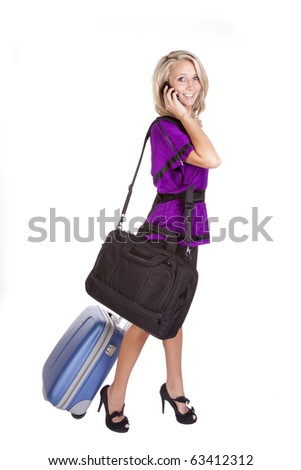 A woman in purple is traveling. - stock photo