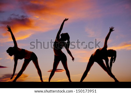 A woman in the sunset silhouetted in three dance positions - stock photo