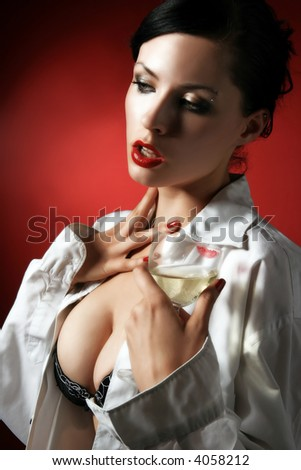 a woman in white is drinking white wine - stock photo