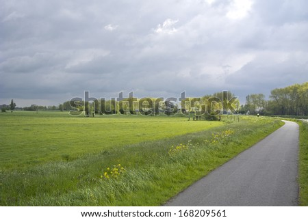 a woman is cycling in the Netherlands - stock photo