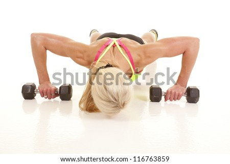 A woman is doing push ups and she is very toned. - stock photo