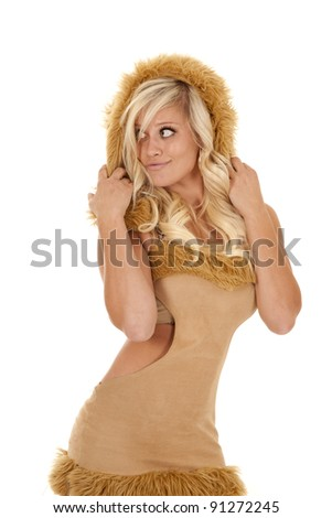 A woman is dressed like an African lion. - stock photo