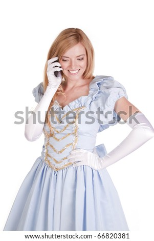 A woman is dressed like Cinderella and talking on the phone. - stock photo