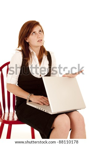 a woman is frustrated with her laptop getting ready to close the lid.