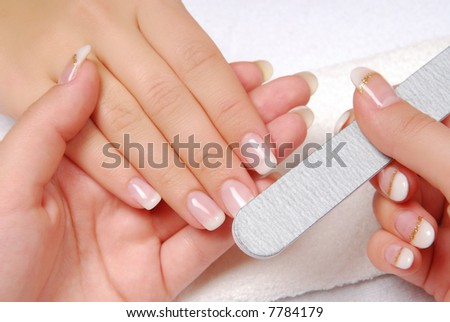 A woman is getting manicure - stock photo
