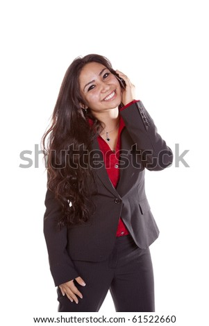 A woman is happy and talking on her cell phone - stock photo