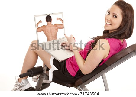 A woman is happy with the man on her computer screen. - stock photo