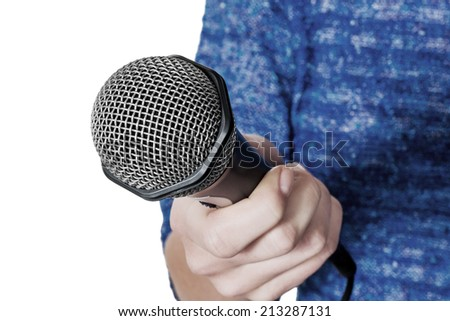 a woman is holding a microphone in hand. interview and opinion poll - stock photo