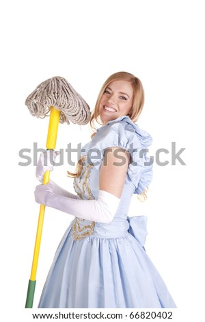 A woman is holding a mop and smiling. - stock photo