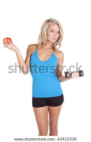 A woman is holding an apple and working out.