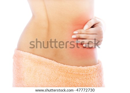 a woman is holding her back in pain - stock photo