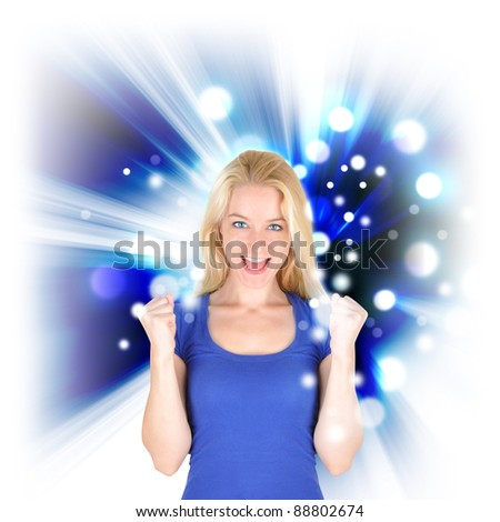 A woman is holding her hand up and looks excited and happy. There is a blue glow with sparkles around her. - stock photo