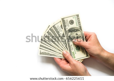 A woman is holding money in her hands. White background. Top view copy space.