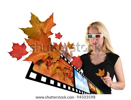 A woman is isolated on a white background with leaves from a film real coming out to represent 3d television. The woman is wearing 3d glasses. - stock photo