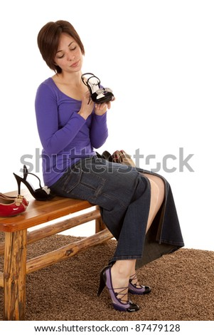 A woman is looking at a fancy pair of shoes wanting them.