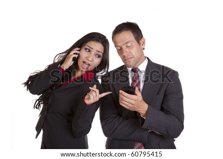 A woman is looking over her shoulder at what a man sees on his cell phone. - stock photo