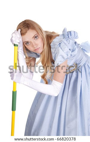 A woman is looking very unhappy leaning on a mop. - stock photo