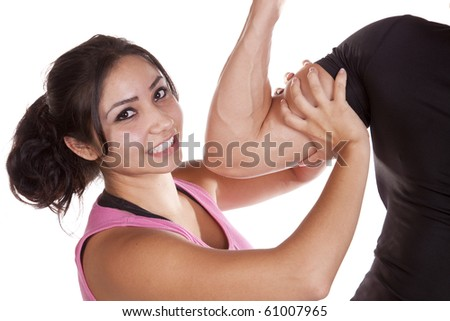 A woman is measuring a mans bicep with her hand - stock photo