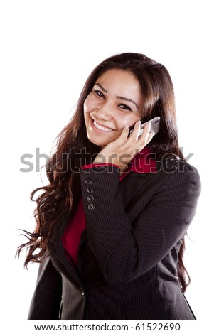 A woman is on her cell phone and smiling. - stock photo