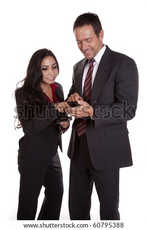 A woman is pointing at a mans cell phone. - stock photo