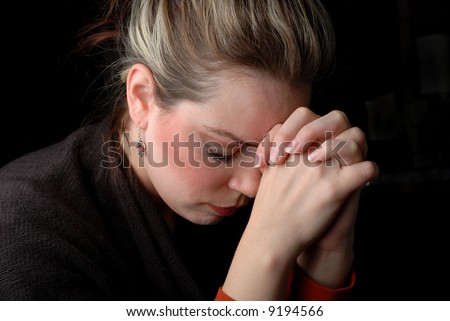 a woman is praying to god with hope - stock photo