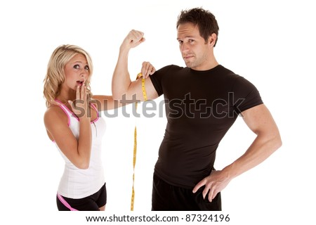A woman is shocked at how big her man's muscles are. - stock photo