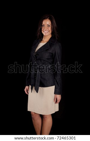 A woman is standing in a dress smiling. - stock photo