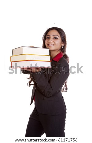 A woman is standing with a stack of books in her arms. - stock photo