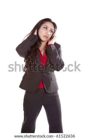 A woman is talking on her cell phone and looks worried. - stock photo