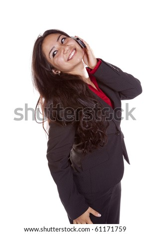 A woman is talking on her cell phone and smiling. - stock photo