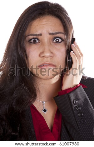 A woman is talking on her cell phone with a very frustrated expression on her face. - stock photo