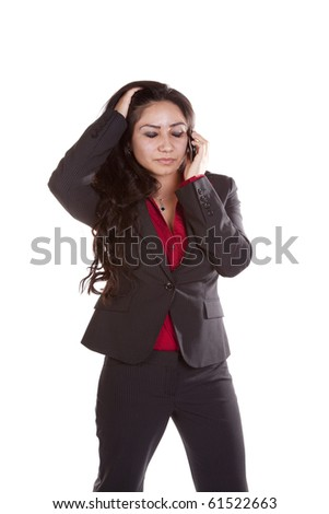 A woman is talking on her phone and looks upset. - stock photo