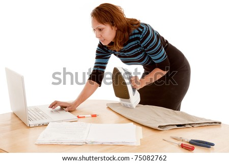 A woman is trying to do her business and house work at the same time. - stock photo