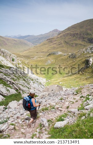 A woman is walking in Aguas Tuertas Valley, Spanish Pyrenees