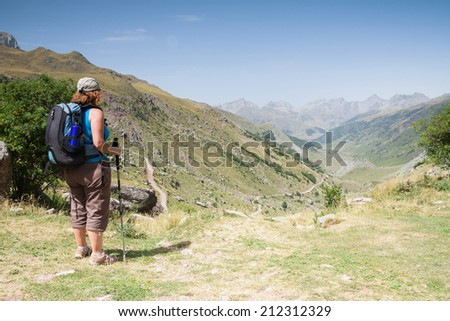 A woman is walking in Hecho's Valley, Spanish Pyrenees