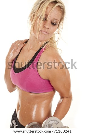 A woman is working out with weights.  She is hot and sweaty. - stock photo