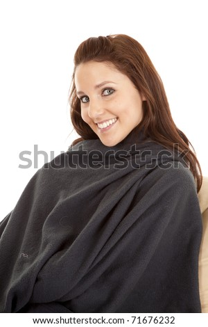 A woman is wrapped in a warm blanket - stock photo