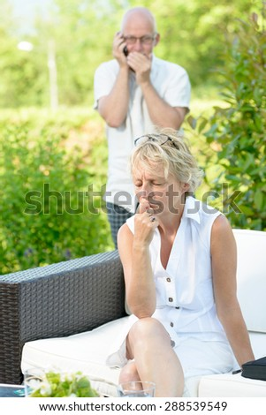 a woman jealous of her husband on phone - stock photo