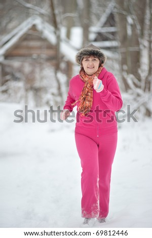 A woman jogging in the winter - stock photo