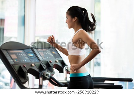 A woman jogging on a treadmill. to lose weight And good health - stock photo