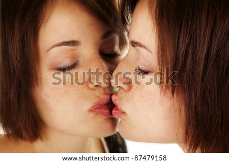 A woman kissing herself in the mirror. - stock photo