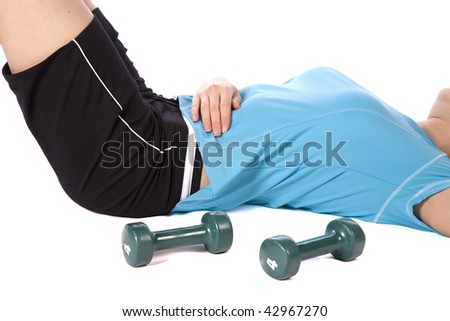 A woman laying down and relaxing after a work out. - stock photo