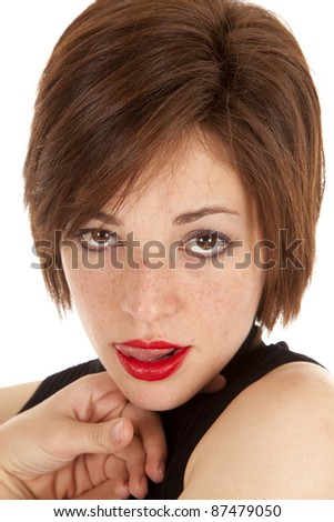 A woman licking her lips trying to show her sexy side. - stock photo