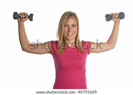 A woman lifting her arms exercising with weights. - stock photo